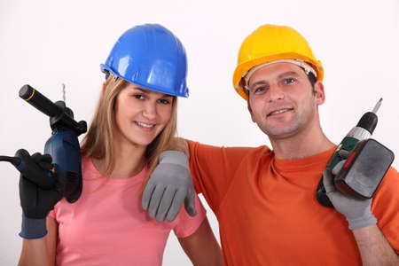 Man and woman with drill Stock Photo - 13812169