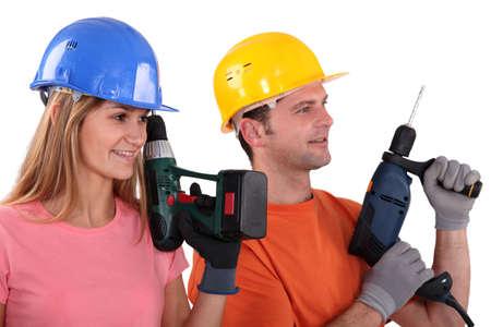 tradespeople: Tradespeople holding power tools