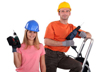 Man and woman with drills Stock Photo - 13806708
