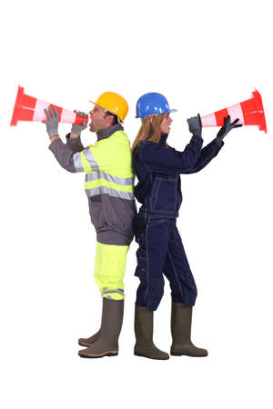 labourers: Labourers shouting in traffic cones Stock Photo