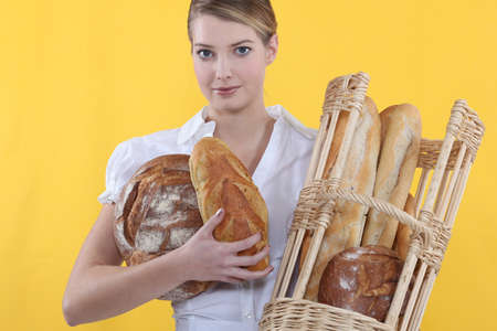 Baker displaying her bread Stock Photo - 13809750