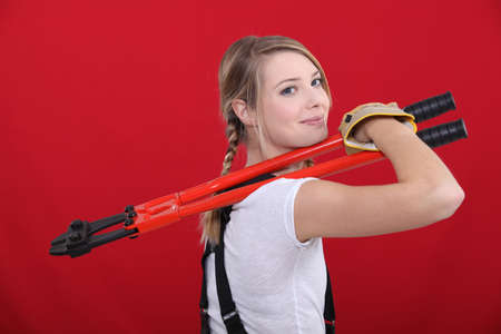 Woman holding bolt cutter Stock Photo - 13809032