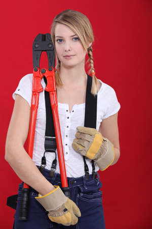 Woman holding bolt-cutters Stock Photo - 13811734