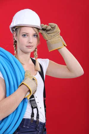Young tradeswoman giving a salute Stock Photo - 13811995