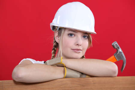 unemotional: Portrait of a construction worker holding a hammer