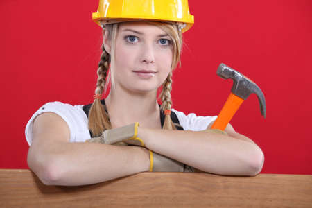 craftswoman: craftswoman holding a hammer Stock Photo