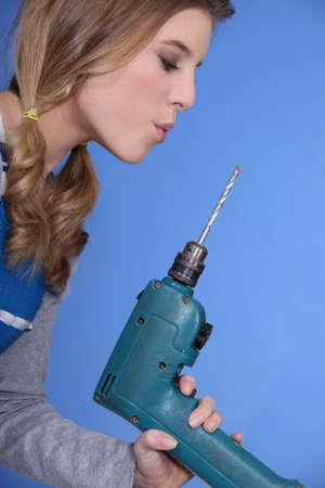 Woman with a power drill Stock Photo - 13811271