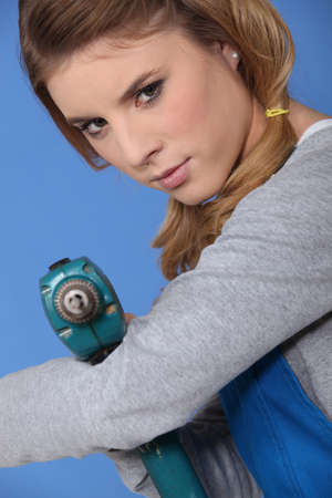 Woman with a drill Stock Photo - 13812101