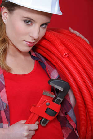 craftswoman: craftswoman holding a spanner and a hose