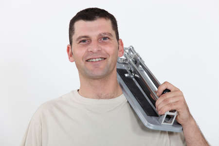 tile cutter: Man with a tile cutter