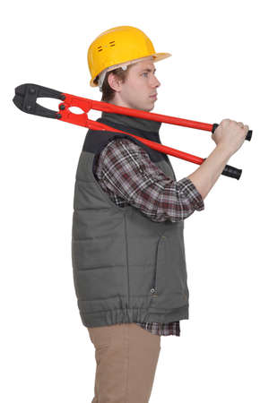 sideway: A construction worker with pliers. Stock Photo