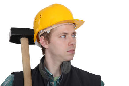 sledgehammer: Young manual worker stood with sledge-hammer