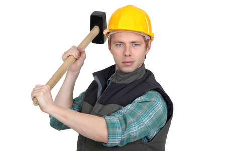 A manual worker with a sledgehammer.