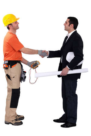 wireman: Architect and electrician shaking hands Stock Photo