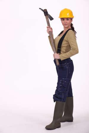 pickaxe: Woman holding a pickaxe