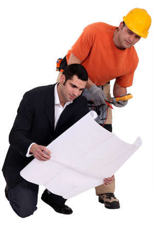 Electrician and architect looking at plans Stock Photo - 13847681