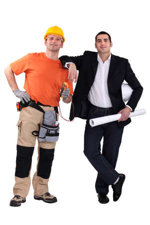 Engineer and construction worker standing side by side photo