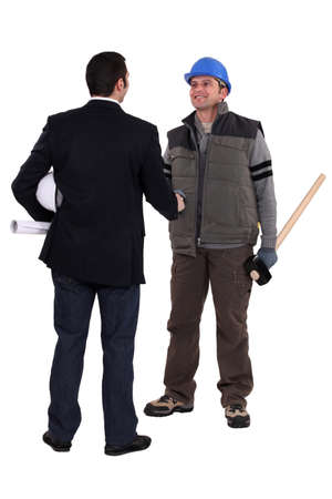 craftsman and businessman shaking hands Stock Photo - 13833011