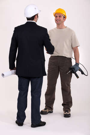 perforate: Architect and construction worker shaking hands