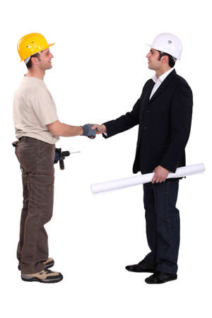Construction workers greeting each other photo
