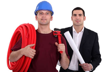Tradesman posing with an engineer photo