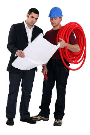 assertive: electrician receiving orders from architect Stock Photo