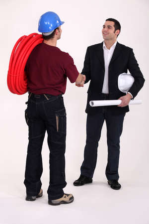 Tradesman and engineer meeting for the first time photo