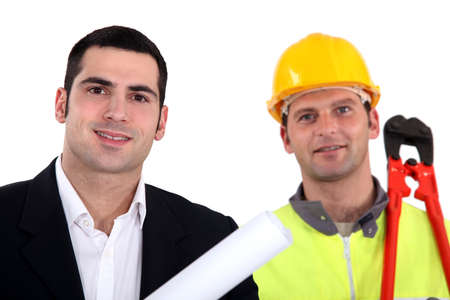 Architect standing with laborer photo