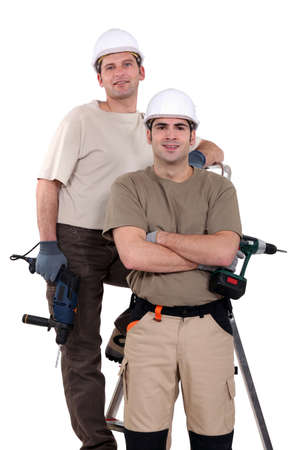 Two men with drills photo