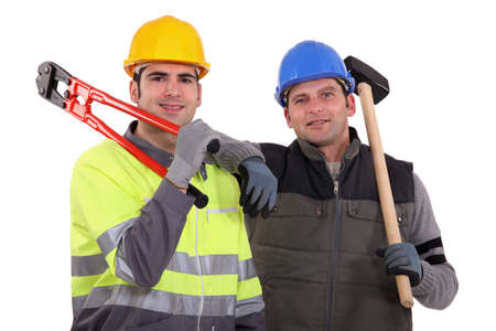 Construction workers with bolt cutters and a sledgehammer