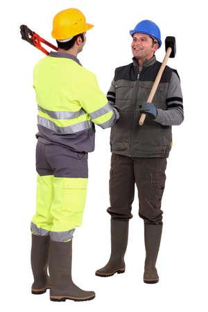 Tradesmen forming a partnership Stock Photo - 13848668