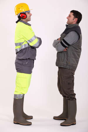 Tradesmen standing face to face Stock Photo - 13882041