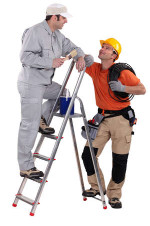 craftsman painter on a ladder speaking with a colleague Stock Photo - 13850821
