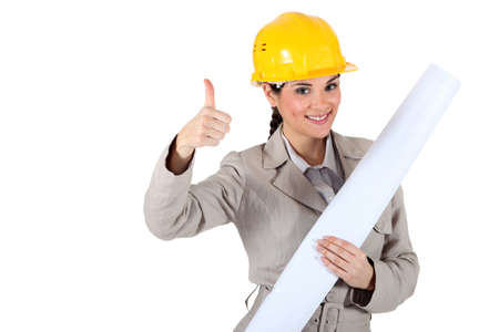 Cheery female architect giving the go-ahead Stock Photo - 13834467