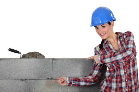 A female mason showing her work. Stock Photo - 13900026