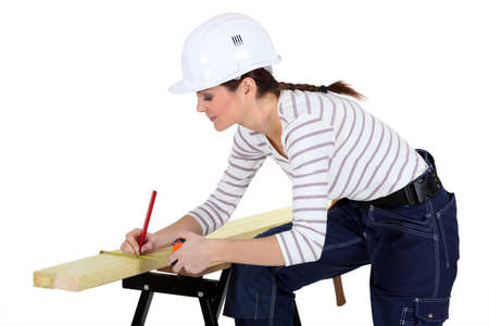 craftswoman measuring a board Stock Photo - 13834473