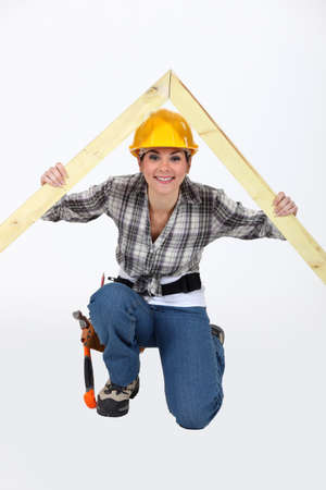 roof beam: Construction worker with a timber apex Stock Photo