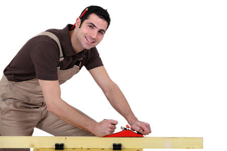 Man with a sander and a pen photo