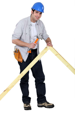 Carpenter nailing a frame Stock Photo - 13852144