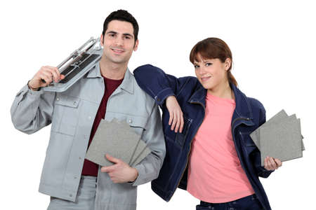 Couple with tile cutting equipment Stock Photo - 13884828
