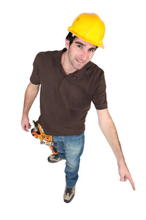 Construction worker pointing to the floor Stock Photo - 13828170