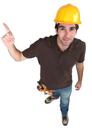 Builder pointing at copyspace photo