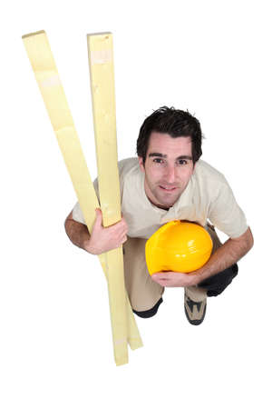 kneeled: A kneeled carpenter. Stock Photo