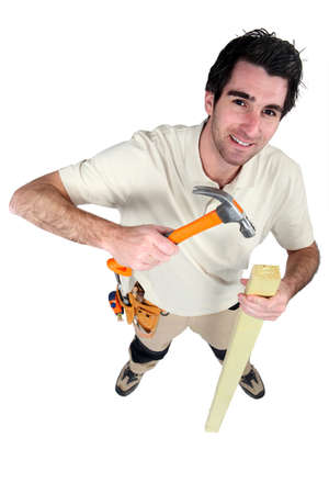 Handyman nailing wood Stock Photo - 13850877