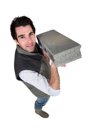 seen: Cement block craftsman in the hands Stock Photo