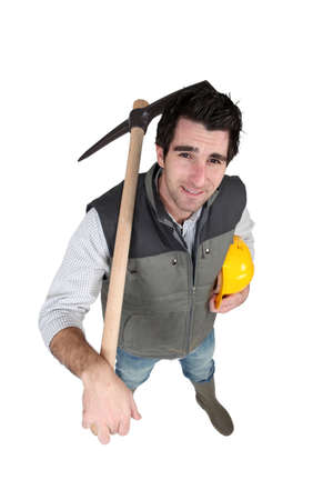 A manual worker with a pickaxe. photo