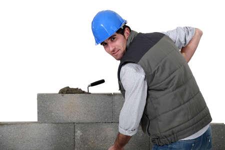 A mason building a wall. photo