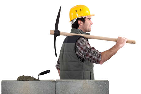 Worker with a pickaxe photo