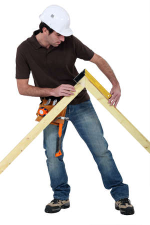 Man measuring truss Stock Photo - 13852236