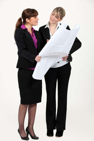 time specification: Two women looking at map